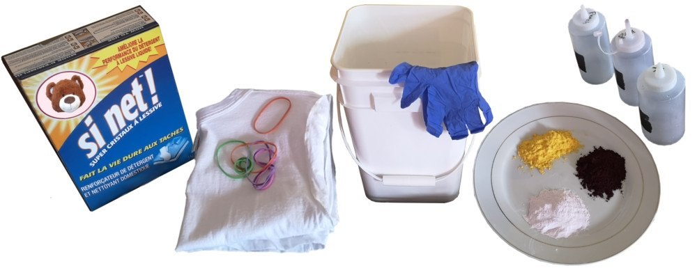 Tools and supplies for tie-dyeing, including soda ash, a shirt, elastic bands, dyes and dye bottles